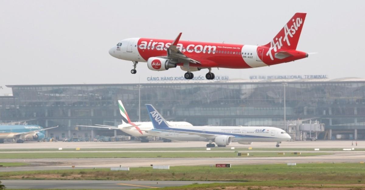 An airplane of AirAsia prepares for landing at Noi Bai international airport in Hanoi, Vietnam April 18, 2019 (Reuters Photo)