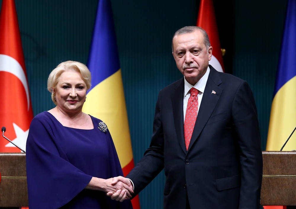 President Recep Tayyip Erdou011fan and Romania's Prime Minister Viorica Dancila shake hands following a joint press conference after their meeting at the Beu015ftepe Presidential Complex in Ankara, Oct. 15.