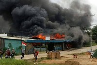 Hundreds flee Indonesia prison after violent riots
