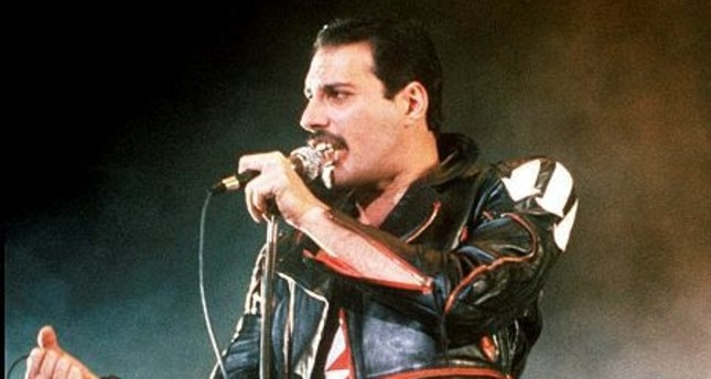 In this 1985 file photo, singer Freddie Mercury of the rock group Queen, performs at a concert in Sydney, Australia. (AP Photo)