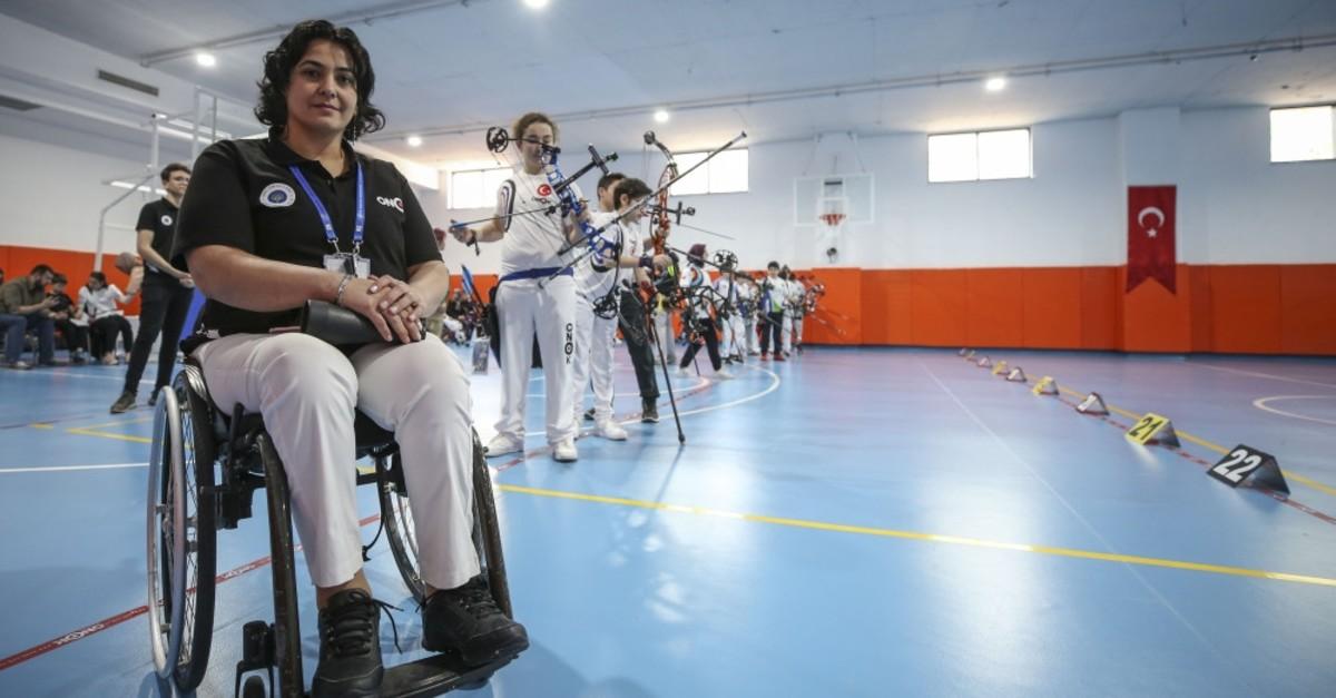 Handan Birou011flu poses at her Onok archery club.