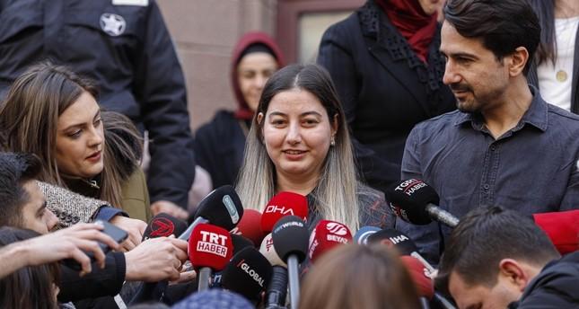 Burcu Öner C speaks to reporters as she leaves the hospital where she has been under quarantine, Ankara, Feb. 14, 2020. DHA Photo