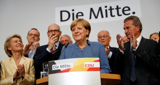 Christian Democratic Union party leader and German Chancellor Angela Merkel reacts to the first exit polls in the German general election, Berlin, Sept. 24.