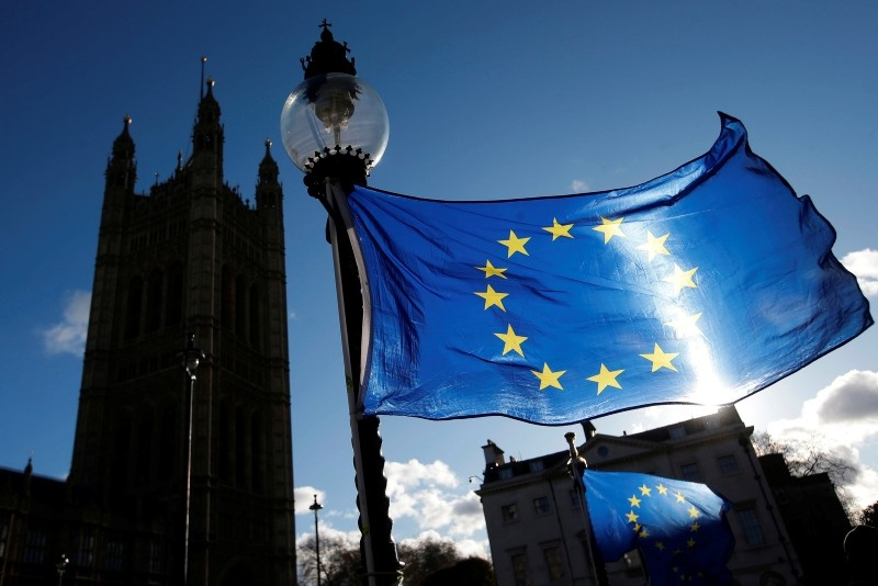 In this file photo taken on December 08, 2017 EU flags are seen attached to a street light outside of the Houses of Parliament in Westminster, central London. (AFP Photo)