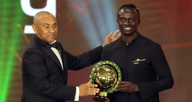 Liverpool and Senegal footballer Sadio Mane R receives his award from CAF President Ahmad Ahmad in Egypt, Jan. 7, 2020. EPA Photo
