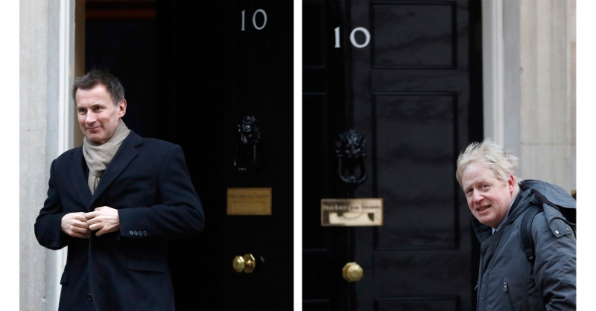 In this two photo file combo image, Jeremy Hunt, left, and Boris Johnson, right, pictured outside 10 Downing Street, who are the final two contenders for leadership of the Conservative Party, it is announced Thursday June 20, 2019. (AP Photo)