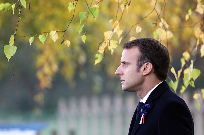 On Nov. 6, 2018, French president Emmanuel Macron pays his respect by the tomb of Lieutenant Robert Porchon, brother-in-arms of French writer Maurice Genevoix killed during World War I at the Trottoir necropolis in Les Eparges. (EPA Photo)