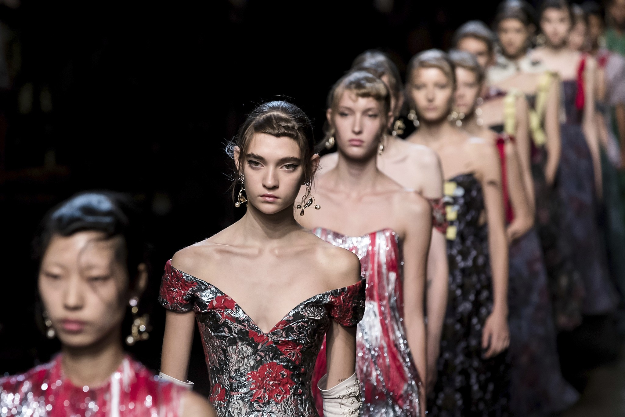 Models wear creations by designer Erdem during the Spring/Summer 2018 runway show at London Fashion Week in London, Sept. 18, 2017. (AP Photo)