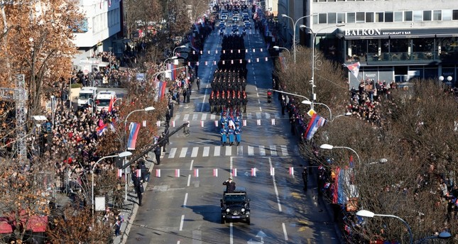 Security forces, firefighters and cultural and sports groups march during an illegal parade in Banja Luka, Wednesday, Jan. 9, 2019. (AP Photo)