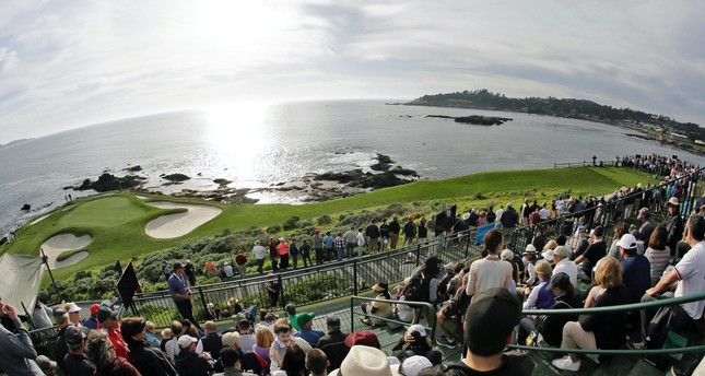 Fans line the seventh hole of the Pebble Beach Golf Links to watch the inaugural $1 million celebrity hole-in-one event of the AT&T Pebble Beach National Pro-Am golf tournament in Pebble Beach, Calif.