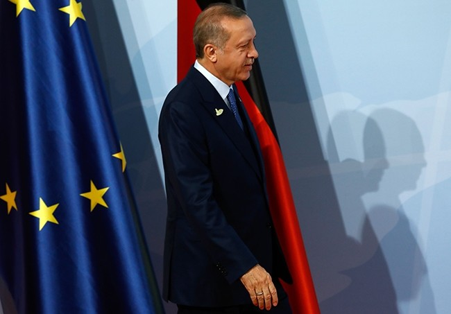 President Recep Tayyip Erdogan walks past the flags of the European Union (L) and Germany as he arrives for the G20 summit in Hamburg, Germany, July 7, 2017. (AFP Photo)
