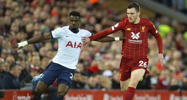Tottenham Hotspur's Serge Aurier (L) in action against Liverpool's Andrew Robertson (R), in Liverpool, Oct. 27, 2019.  (EPA Photo)
