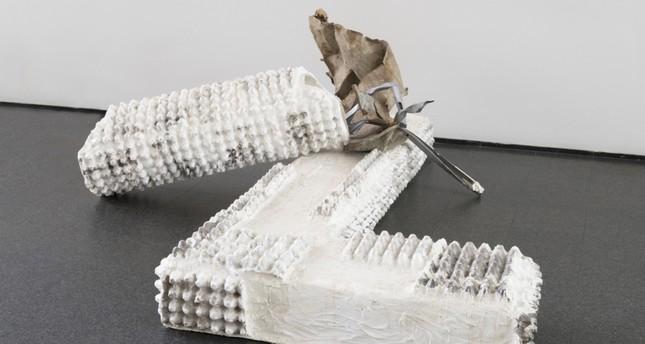 "Jumana Manna, American, b. 1987, ""Kollek, Olmert, Lupolianski and Barkat's Picnic in Silwan, Lord Kitchener's Neck,"" 2014, egg cartons, plaster, burlap, wax, and scrap metal Installed, 78.7 × 233.7 × 218.4 cm."