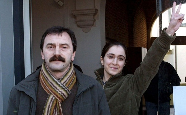This file photo dated Jan. 27, 2006 shows Musa Au015fou011flu (L) walking next to Fehriye Erdal, a DHKP-C militant who took part in the notorious 1996 Sabancu0131 murder, while leaving the courthouse in Belgian city of Brugge.
