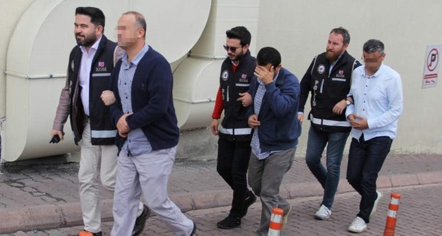 Police escort three suspects to the courthouse after they were arrested in operations in Kayseri, Oct. 22, 2019. (DHA Photo)