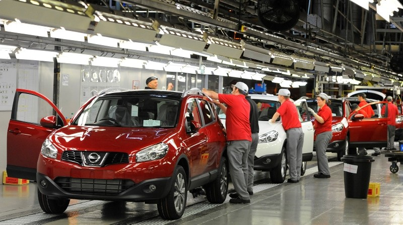 A worker is seen completing final checks on the production line at Nissan car plant in Sunderland, northern England, June 24, 2010. (Reuters Photo)
