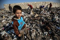 Syrian children in war-torn Idlib scrape out living in garbage dumps