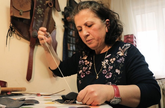 Şükriye Bal sews various clothes and materials used in archery, a hobby that has now turned into a business.