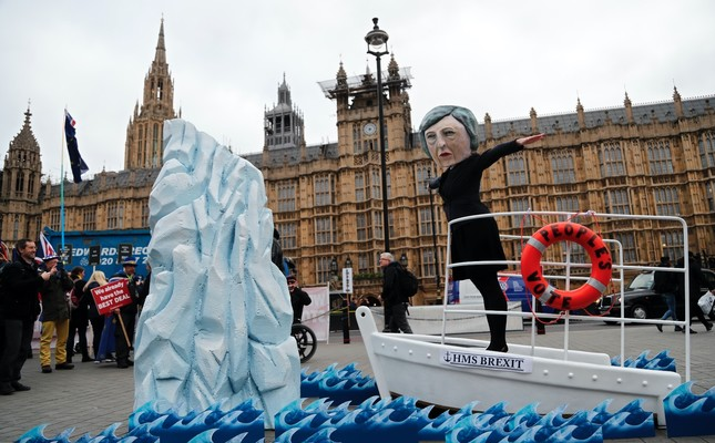 An activist wears a mask of Britain's Prime Minister Theresa May during an anti-Brexit demonstration, in front of the Houses of Parliament, London, Jan. 15.