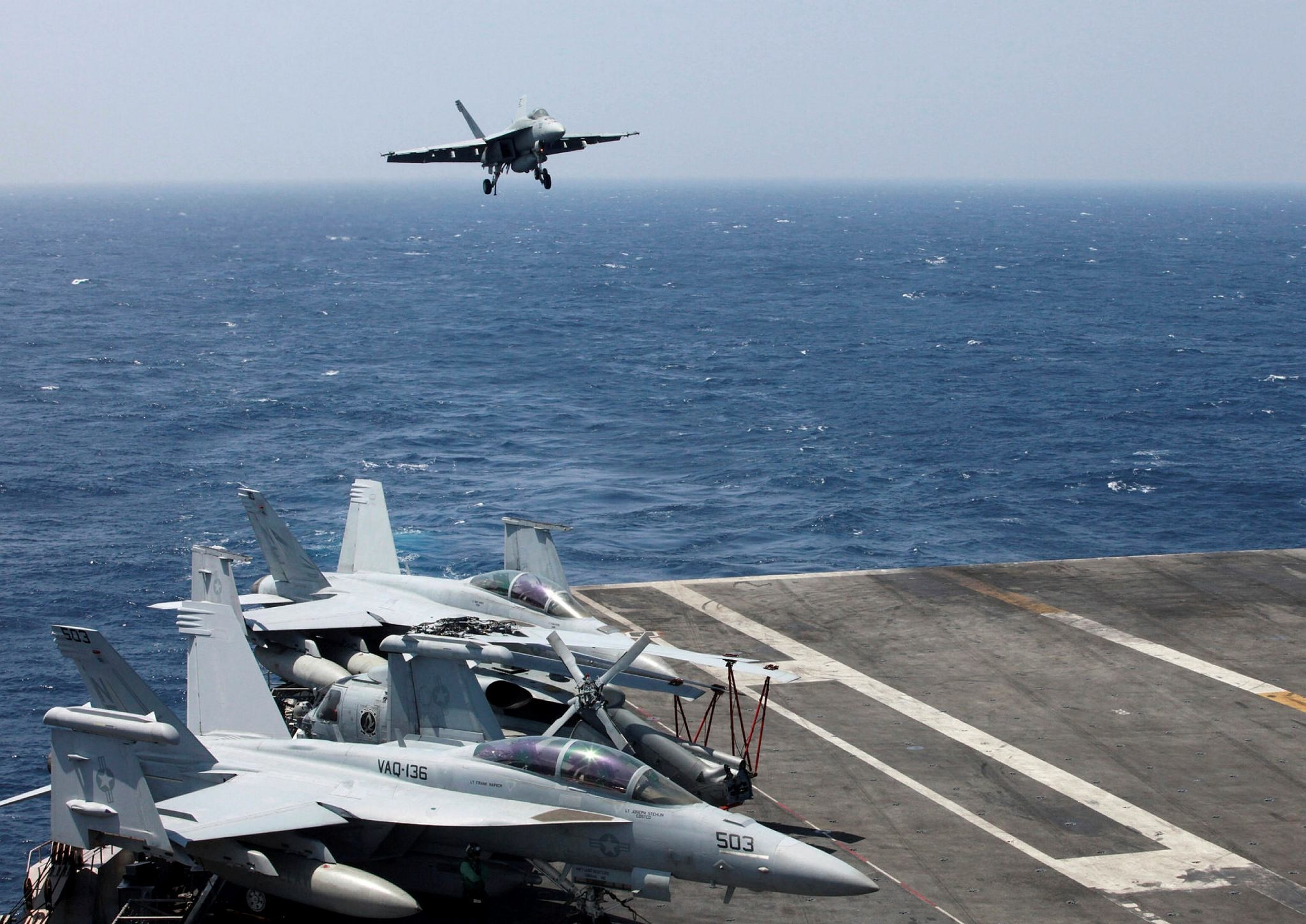 A F18 fighter jet lands on the U.S. Navy aircraft carrier USS Carl Vinson (CVN 70) following a patrol off the disputed South China Sea on March 3.