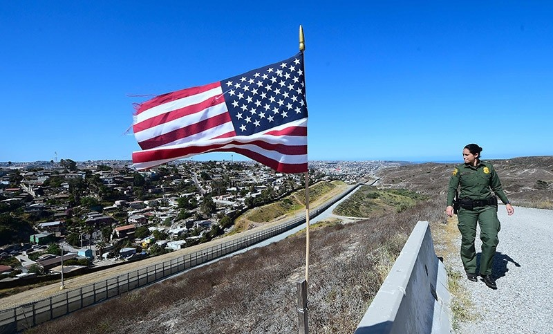 US Customs and Border Protection agent Tekae Michael patrols from within the Border Infrastructure System which runs for 14 miles inland from the Pacific Ocean seperating California from Mexico on April 17, 2018 in San Diego, California. (AFP Photo)