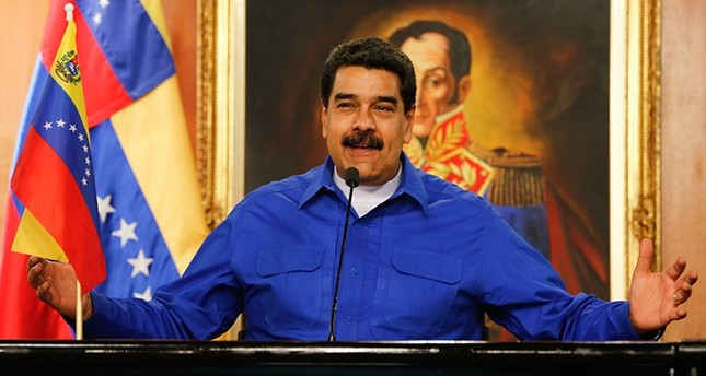 Venezuelans go to polls in tight race between Maduro and opposition