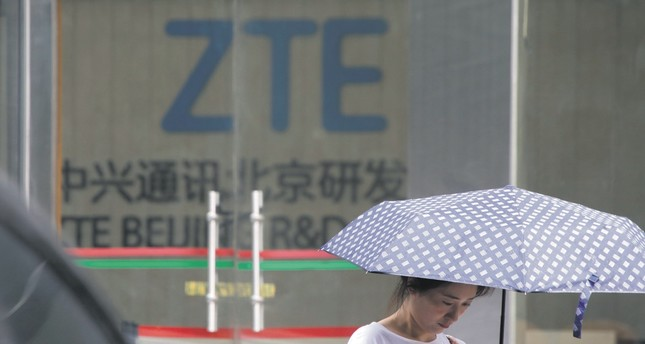 A woman stands outside ZTE Beijing research and development center in Beijing.