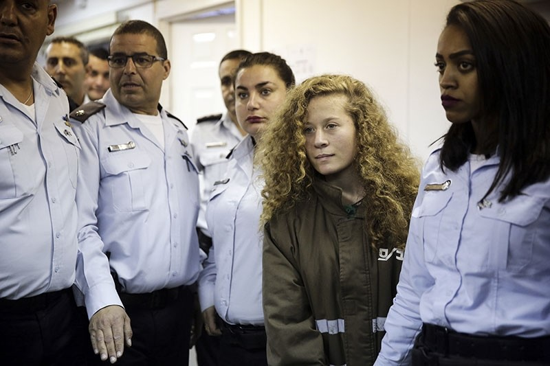 Ahed Tamimi is brought to a courtroom inside Ofer military prison near Jerusalem, Thursday, Dec. 28, 2017. (AP Photo)