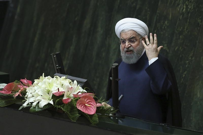 Iranian President Hassan Rouhani speaks at a session of parliament before a vote of confidence for his cabinet, in Tehran, Iran, Sunday, Aug. 20, 2017 (AP Photo)