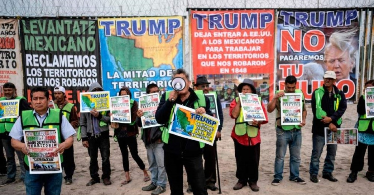 Members of Border Angels and Alianza Migrante (Migrant Alliance) demonstrate against U.S. President Donald Trump at the US-Mexico border in Playas de Tijuana, Baja California state, Mexico, on Feb. 2, 2020. (AFP Photo)