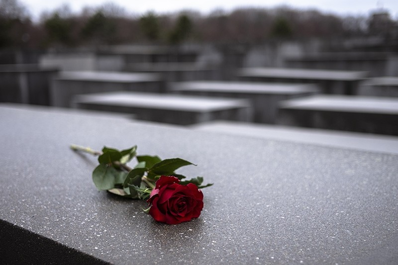 A red rose lies on a slab of the Holocaust Memorial to commemorate the victims of the Nazis in Berlin, Sunday, Jan. 27, 2019. (AP Photo)