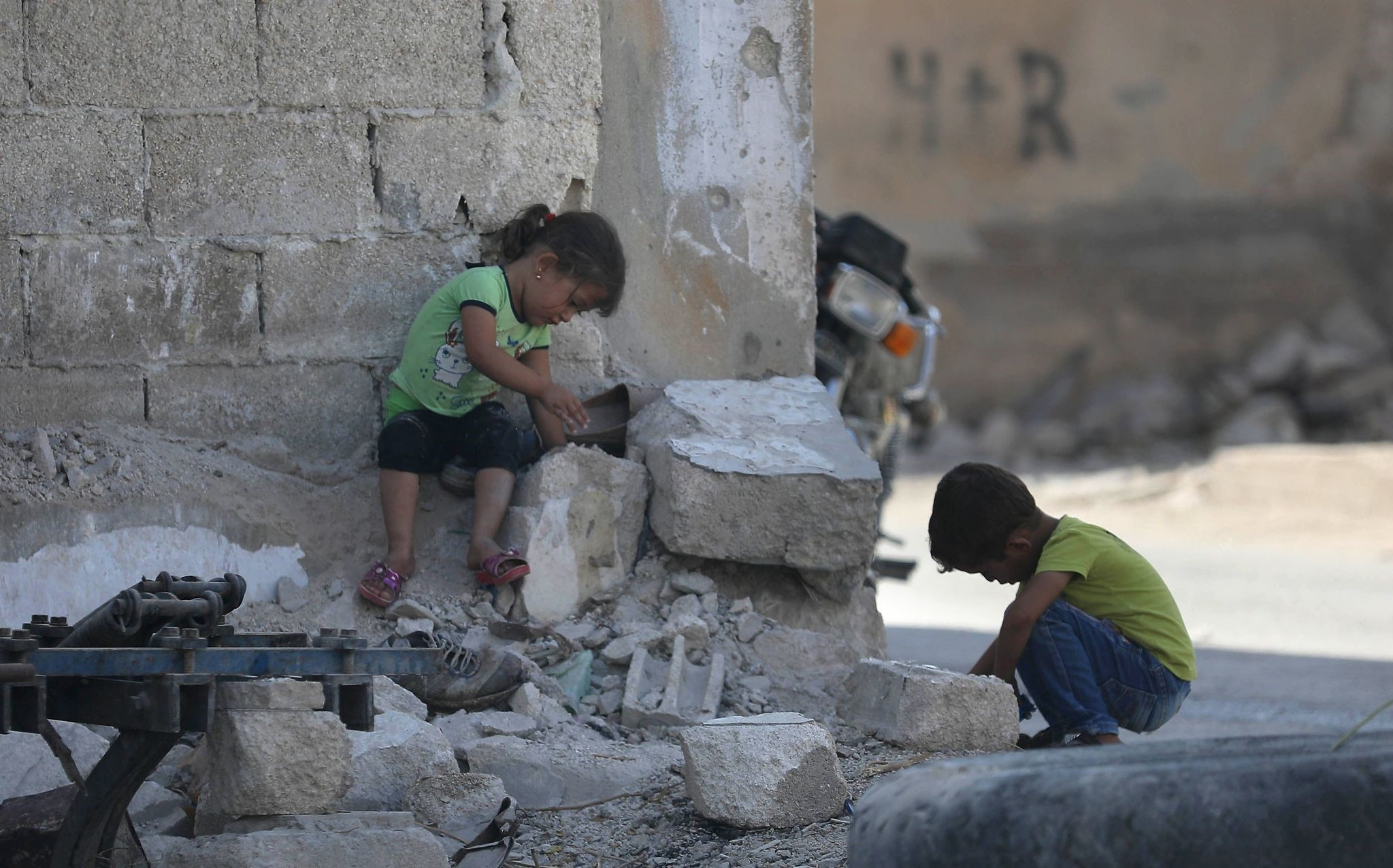 Syrian children play in Morek, a town in the northern countryside neighboring Idlib, where Turkey and Russia recently reached an agreement to establish a demilitarized zone to stop the escalating crisis in the province, Sept. 18.