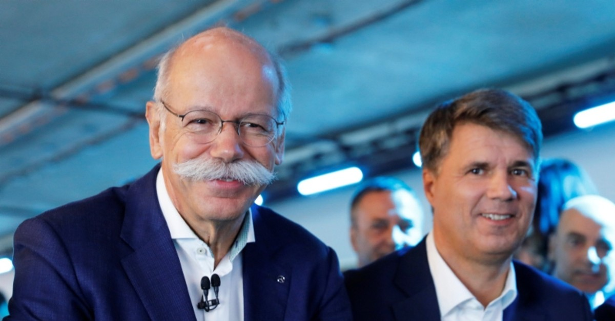 Harald Kruger, CEO of BMW AG and Dieter Zetsche, CEO of Daimler AG, attend a news conference to present plans for combining the companies' car-sharing businesses, in Berlin, Germany, February 22, 2019. (REUTERS Photo)