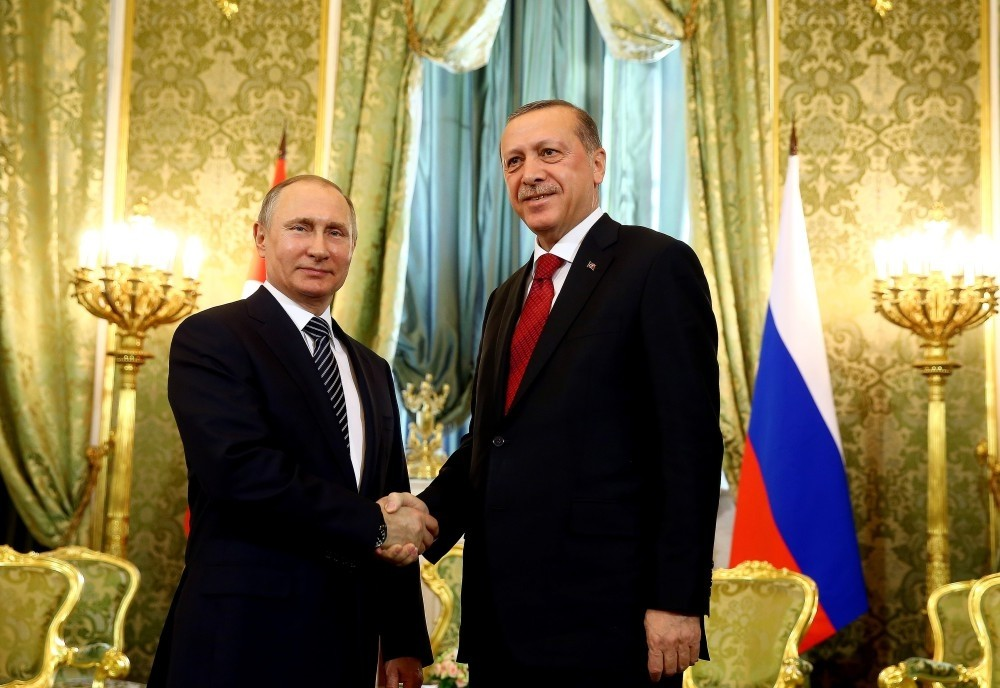 Putin (L) & Erdou011fan pose for press during Erdou011fanu2019s March 10 Russia visit. Although relationship between Turkey & Russia was tense after downed Russian jet, Putin reassured Erdou011fan Russia was on Turkeyu2019s side against coup plotters, mending relations.