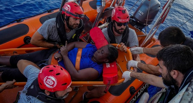 NBA Memphis player Marc Gasol and members of NGO Proactiva Open Arms rescue boat carry African migrant in central Mediterranean Sea, July 17, 2018. (REUTERS Photo)