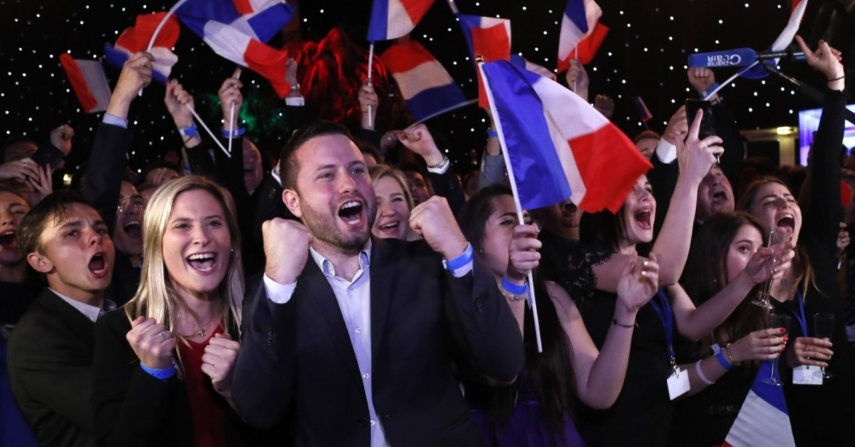 Far-right supporters react at their campaign headquarters, Paris, May 26, 2019.