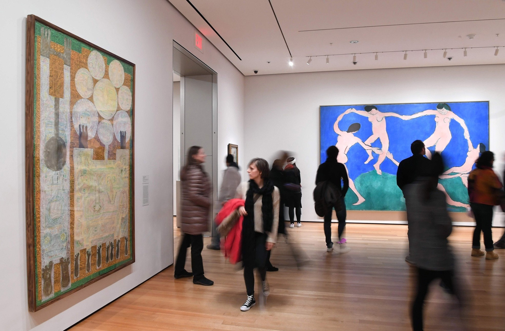 Visitors look at artwork by Iranian painter and sculptor Charles Hossein Zenderoudi on Friday at the Museum of Modern Art in New York.