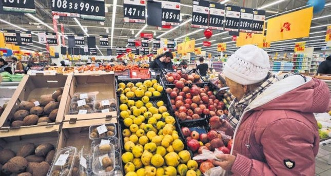 A Russian woman chooses Turkish fruits at a supermarket in St. Petersburg, Russia, Dec. 2, 2015. EPA File Photo