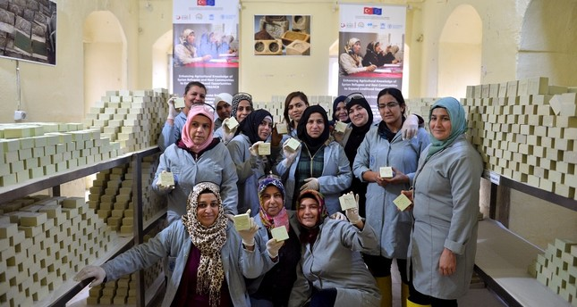 Syrian and Turkish women show Aleppo soaps they made together in their workshop in Mardin, Feb. 21, 2019.