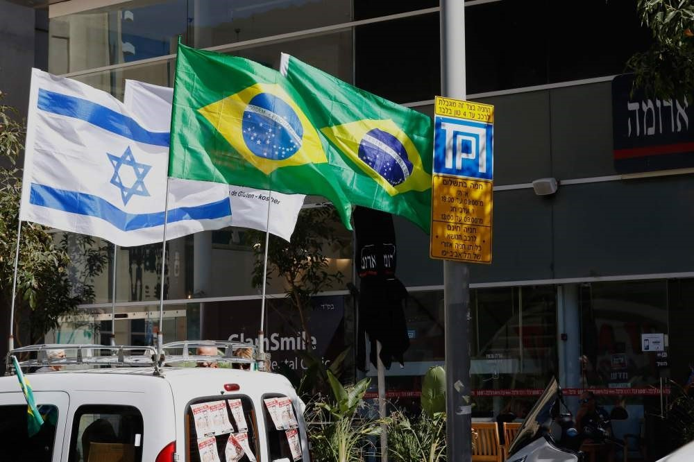 Israeli and Brazilian flags hang outside the building housing the offices of the Brazilian Embassy, Tel Aviv, Oct. 28.