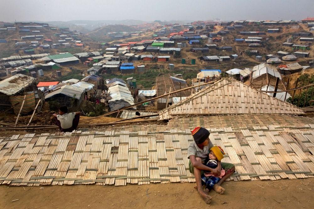 A Rohingya boy holds his sibling in the Balukhali refugee camp, Cox's Bazar, Bangladesh, Jan. 15.