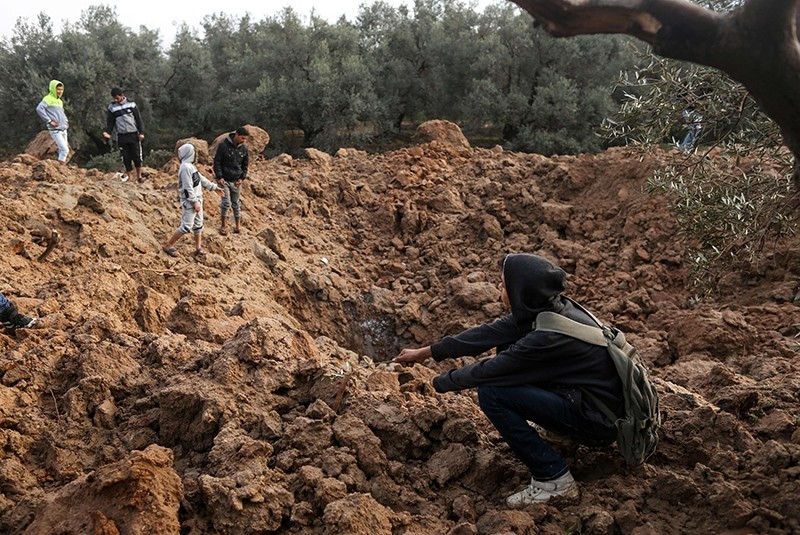 Palestinians check the site of an Israeli airstrike in Gaza City, Feb. 18, 2018. (AFP Photo)