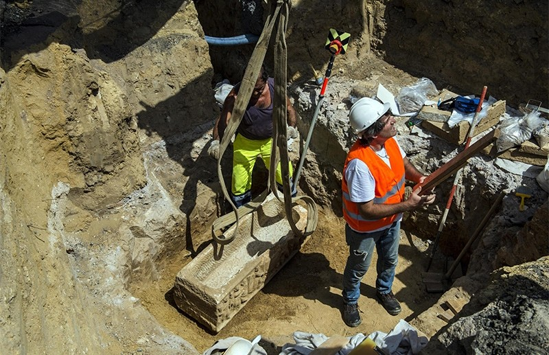 A handout photo made available by the Rome Press Office shows that two Roman sarcophagi have been found during work to place pipes near the Olympic Stadium, in Rome, 23 August 2017