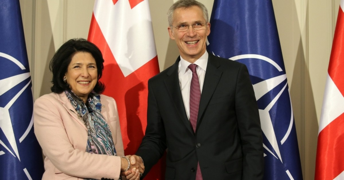 Georgian President Salome Zourabichvili shakes hands with NATO Secretary General Jens Stoltenberg during a meeting in Tbilisi, Georgia, March 25, 2019. (Reuters Photo)