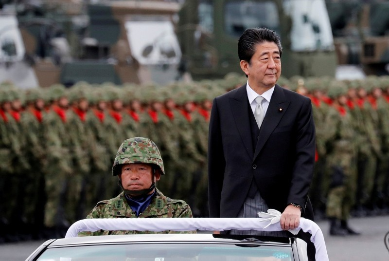 Japanese Prime Minister Shinzo Abe reviews Japanese Self-Defence Forces' (SDF) troops during the annual SDF ceremony at Asaka Base in Asaka, north of Tokyo, Japan, October 14, 2018. (Reuters Photo)