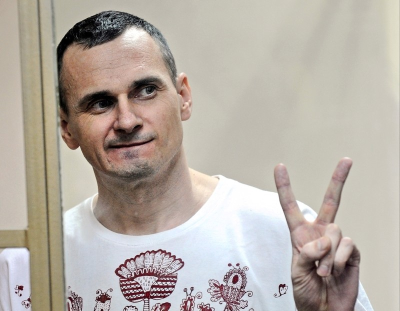 In this Tuesday, Aug. 25, 2015 file photo, Oleg Sentsov gestures as the verdict is delivered, as he stands behind bars at a court in Rostov-on-Don, Russia. (AP Photo)