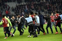French football team Lille files complaint against fans who invaded pitch, attacked players