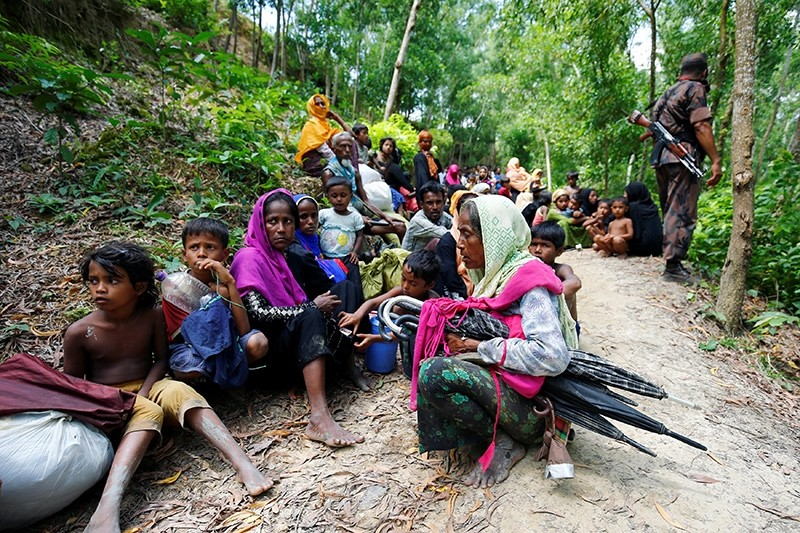 Rohingya people sits on the Bangladesh side as they are restricted by the members of Border Guards Bangladesh (BGB), to go further inside Bangladesh, in Coxu2019s Bazar, Bangladesh August 28, 2017 (Reuters Photo)