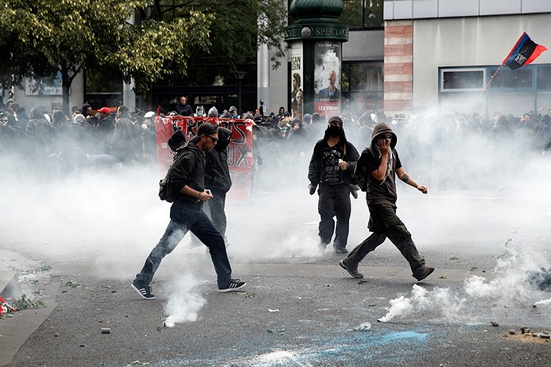 Protesters riot during a demonstration against French government's labor reforms in Paris, France, Sept. 12, 2017. (EPA Photo)