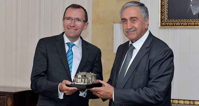 U.N. Secretary General's Special Advisor for Cyprus Espen Barth Eide (L) poses for photo with Turkish Cypriot leader Mustafa Akıncı, August 3, 2017, Nicosia, Turkish Republic of Northern Cyprus. (IHA Photo)
